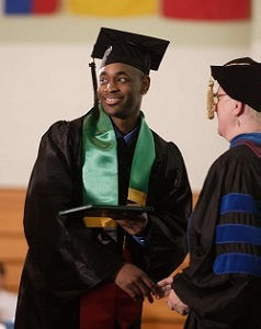 student being handed degree