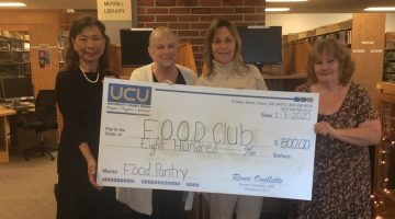 Club members pose with oversized check.