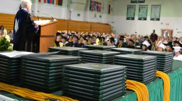 Diplomas stacked at Commencement
