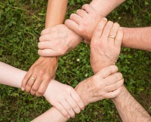 Hands held together in a group