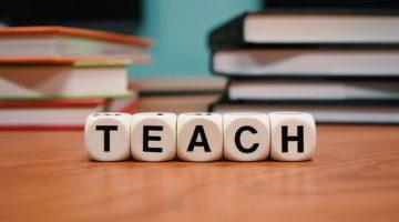 "Tiles spelling the word ""teach."""