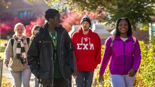 Group of students walking around campus